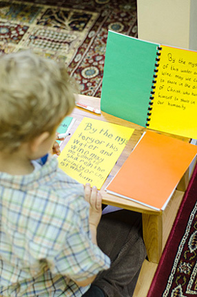 Child learns about the Mass at Divinum Auxilium Academy