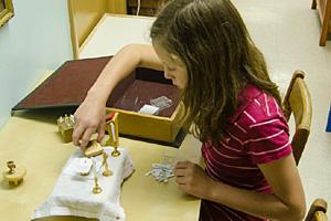Child with Mass Kit at Divinum Auxilium Academy