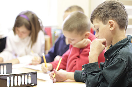 Students complete assignments at Divinum Auxilium Academy