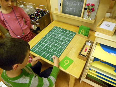 Child Practices Writing Numerals